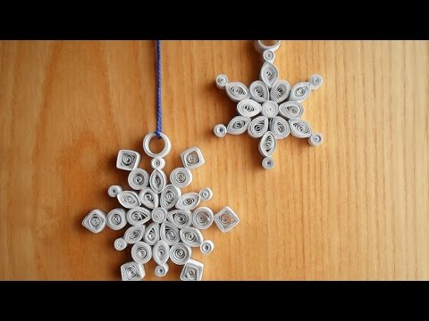 Fiocco di neve con strisce di carta in tecnica Quilling