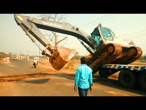Volvo Excavator Uploading on Truck By skilled Driver - Amazing Video