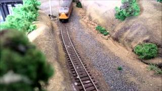 Management got the Old Bachmann FA for the first run. Its been with us since the beginning with faultless performance.The GP35's will be on next time. Here we see a run thorugh the Junction to the Southern Terminus.