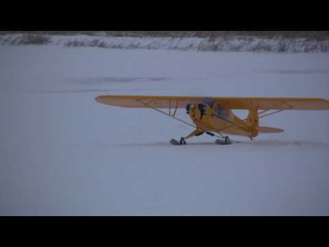 RC J-3 CUBS FLY IN SNOW