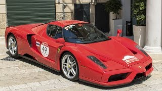 """Here another video from the most exclusive Ferrari Gathering ever, the FERRARI CAVALCADE 2017, and it's only one of many videos I've recorded in Apulia, so be sure to not miss any of these watching the appropriate playlist I've created for.This year at its sixth edition, the Cavalcade is a special event organized directly by Ferrari to give the possibility to its most important members to drive all the brand new Ferraris on the wonderful scenary of the italian roads. This Gran Turismo event is reserved to the most important owners from all over the world, and to take part at the Cavalcade you need to have 5 different Ferraris in your garage.The Ferrari Cavalcade 2017 was held in beautiful Puglia, in south Italy touching the most beautiful places of the world driving across the Trulli of Alberobello, Bari, Polignano a Mare and the unique """"Sassi di Matera"""" in Basilicata. More than 100 of most imressive Ferraris crew, including 5 different Ferrari LaFerrari Aperta for a total of over 15 LaF, the brand new Ferrari GTC4 Lusso and several other Ferraris joined the 6th edition, enjoying the sun of Italy in the center of the european history.In this video 2 stunning red Ferrari Enzo with Montana and spanish licence plate takes part at the event giving me the possibility to film them in each detail like rims, engine, interior, the logo of the """"Cavallino"""" and to record their noisy start-up and their lovely sound while driving.The Ferrari Enzo is an italian hypercar produced by the manufacturer of Maranello, Italy since 2002 to replace the legendary Ferrari F50.The car takes is name from the """"Cavallino Rampante""""'s founder Enzo Ferrari, maybe the man who gave more to the automotive world creating the best and most prestioug Formula 1 team of the history.The design is signed Ken Okuyama, already father of the Maserati Birdacage 75th Anniversary and of the Ferrari Rossa concept, for Pininfarina and is characterized by a square shape with sharp lines showing the Enzo Ferrari's sig"""