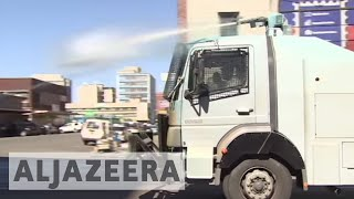 Zimbabwe: Riot police fire tear gas, water cannon at protesters Riot police in Zimbabwe have fired tear gas and water cannon to...