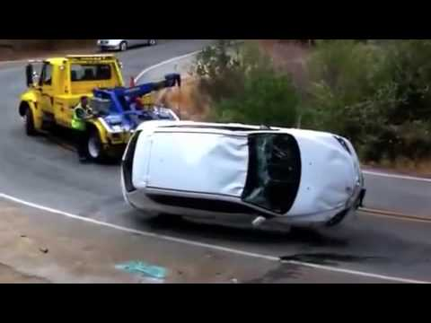 The ultimate tow truck fail results in bad day for Mazda driver