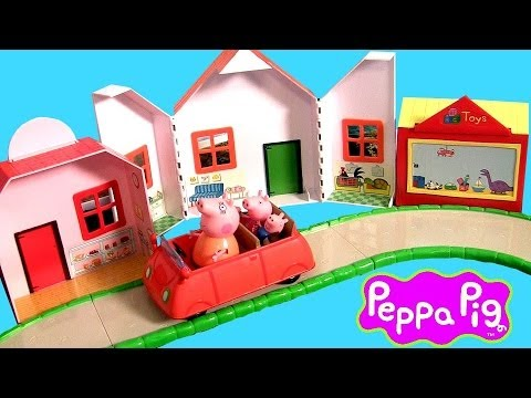 Toy Store - Disneycollector presents from Nickelodeon Peppa Pig Shopping Playset. Comes with 3 Buildings: Vet, Toy Store & Cafe Bakery Shop. Also includes: Peppa's red Car along with 3 figurines of Mummy...