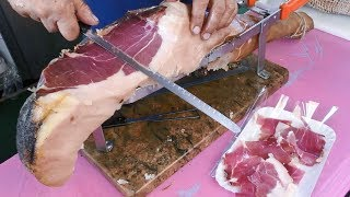 Download Video Italy Street Food. Slicing a Huge Dry-Cured Ham. MP3 3GP MP4