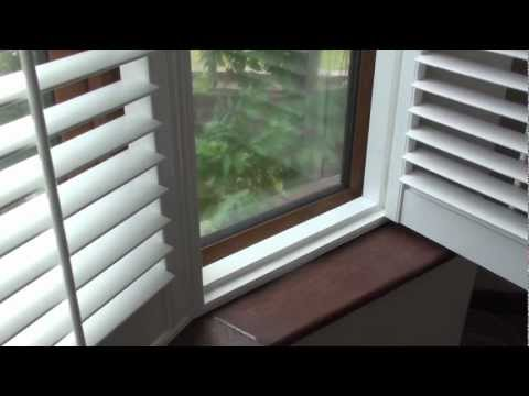 Bay window shutters fitted to a 5 section round bay window