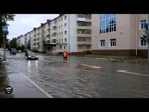 Потоп на дороге возле Администрации города Югорска 30.06.2015г.
