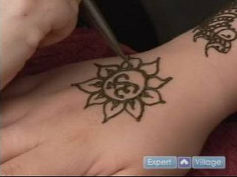 How to Do Henna Tattoos : How to Draw a Lotus Flower Around Ohm Design with Henna Video