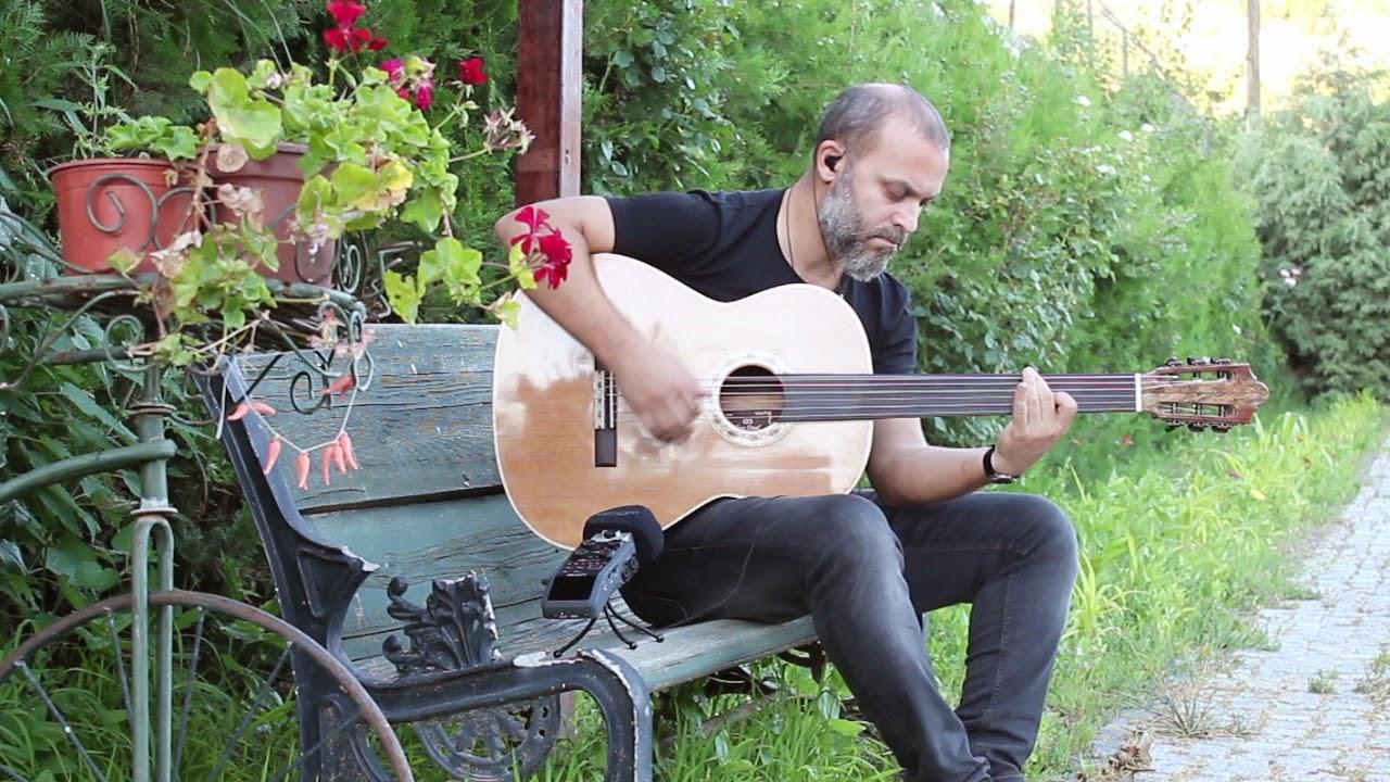 Cenk Erdogan  plays Baritone Fretless Acoustic Guitar
