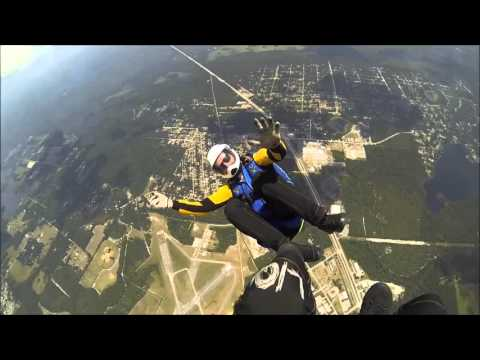 Skydivers play mid-air tag and have a beer to celebrate!