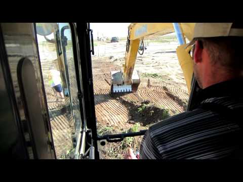 PC200 Stripping Top Soil Off a Pipeline
