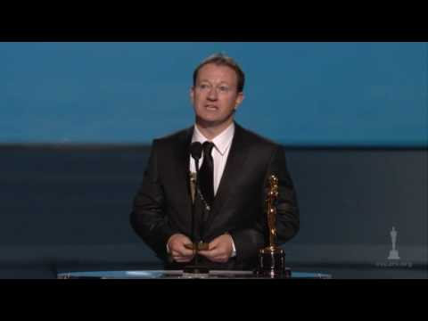 slumdog - Tina Fey and Steve Martin presenting Simon Beaufoy with the Oscar® for Best Adapted Screenplay for