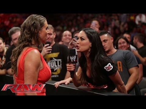 stephanie - Brie Bella supports her sister, Nikki Bella, from the front row on Raw.