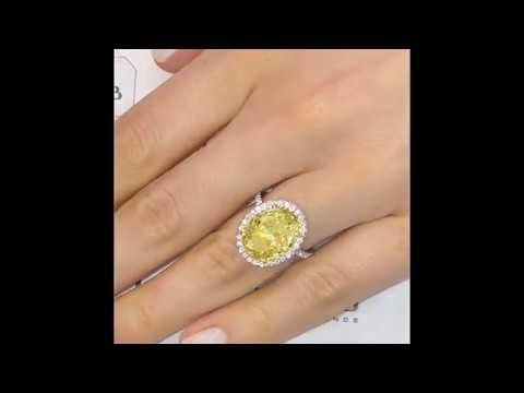 7.10 Carat Yellow Oval Diamond Halo Engagement Ring