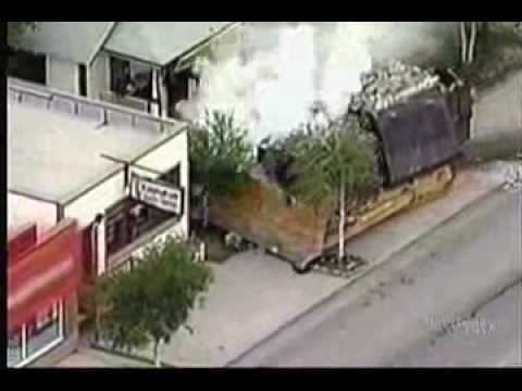 Man Makes homemade tank and destroys half of his town; Police have no way to stop him
