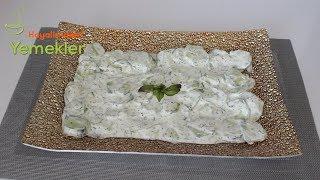 https://www.hayalimdekiyemekler.com/mezeler-ve-salatalar/yogurtlu-salatalik-mezesi/Yoğurtlu salatalık mezesi 2  veya 3 adet  salatalık1 su bardağı yoğurt2 yemek kaşıı mayonezYarım yemek kaşı kuru naneBiraz tuz Yoğurtlu salatalık mezesi nasıl yapılırSalatalıkları alacalı soyun yıkayın ve ince ince dilimleyin.Mayonez, yoğurt, salatalık,tuz ve kuru nane iyice karıştırın ve servis yapın.Afiyet olsunSayfalarımı takibe alabilirsiniz :)Resimli Detaylı Püf Noktalarıyla Yemek Tarifleri http://www.hayalimdekiyemekler.com/Facebook : https://www.facebook.com/pages/Hayalimdekiyemekler/284836254958186?hc_location=timelineInstagram : http://instagram.com/hayalimdekiyemekler/Pinterest: http://tr.pinterest.com/0s0gfu6kgyq6qbj/Yeni Tarifler için Telefonunuza indirmek isterseniz,verdiğim linklerden hemen indirebilirsiniz ve uygulamamıza puan vermeyi, yorum yapmayı unutmayın :) İos Uygulama ( Appstore )  : https://itunes.apple.com/fr/app/hayalimdeki-yemekler/id1117374761?l=en&mt=8Android Uygulama için ( Gogle Play )  : https://play.google.com/store/apps/details?id=com.hayalimdekiyemekler&hl=trYoutube Kanalıma Abone olun :) https://www.youtube.com/channel/UCpwA5ZcoyBCOJDHJEzQP_Cg