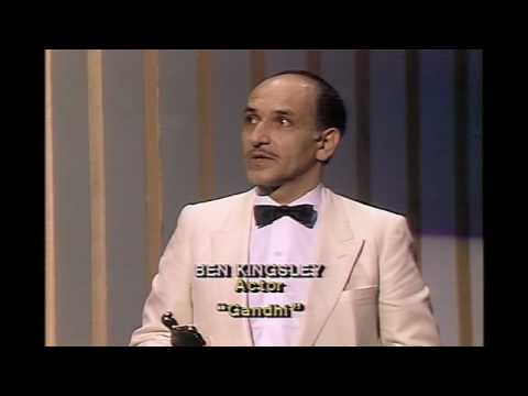 ben kingsley - John Travolta presenting Ben Kingsley with the Best Actor Oscar® for his performance in