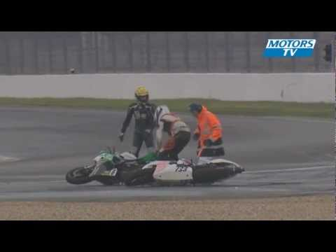A bike racer tries to get back on his bike after a crash which was no fault of his and then this happens