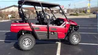 4. 2013 Kawasaki Teryx4 750 4x4 EPS LE in Firecracker Red at Tommy's Motorsports