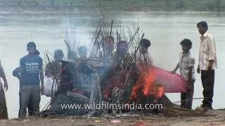 Cremation fire on ghats of Yamuna river in Vrindavan