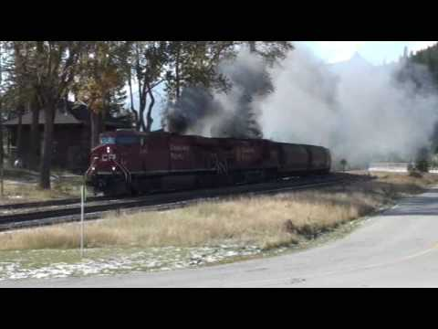 ES44AC - On a very windy day, a train of grain hoppers smokes its way into Field. Led by ES44AC 8707 it smokes its way towards the spiral tunnels. See my other video'...