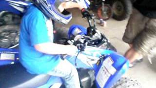 2. Tristan Lalonde getting his 2011 yamaha raptor 90 May 2010 082.avi