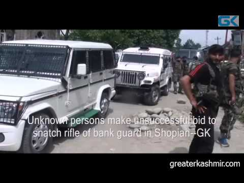 Unknown persons make unsuccessful bid to snatch rifle of bank guard in Shopian