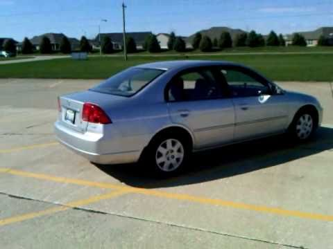 2002 honda civic ex sedan - I created this video at http://www.youtube.com/editor. This car belongs to my grandparents. It is a seventh generation (2001-2005) Civic. Silver with the gre...