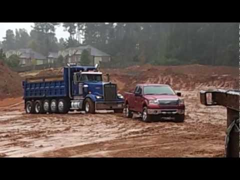my ford f150 in the mud pulling out a stuck dump truck