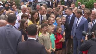 Prince William and Catherine, Duchess of Cambridge, happily stopped to take photos with local children whilst visiting a local market in Heidelberg, Germany. The tour is part of their five-day goodwill visit to Poland and Germany.