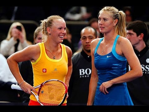 Maria Sharapova & Caroline Wozniacki dance with a fan!