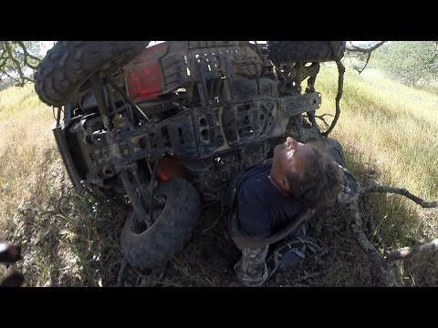 Heroic biker saves man trapped underneath ATV