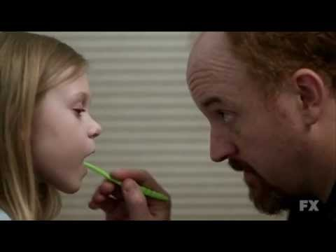 Louie gives the finger to his daughter