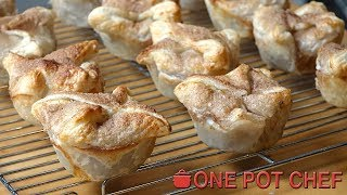 """Cheater's Mini Apple Pies is a no-fuss, simplified version of the classic dessert! Pie apples are combined with brown sugar and cinnamon, then baked in an envelope of puff pastry. Topped with cinnamon sugar, these gorgeous little pies can be served hot or cold, or even frozen for later use - give it a try today!Ingredients:3 Sheets of Frozen Ready Rolled Puff Pastry (thawed)800g Can of Pie Apples1/4 Cup of Brown Sugar1 Teaspoon of Ground Cinnamon1 Egg2 Tablespoons of Cinnamon SugarPreparation Time: About 10 minutesCooking Time: About 20 - 25 minutesMAKES 12 MINI PIESSubscribe to One Pot Chef (it's free!):http://bit.ly/SubOPCONE POT CHEF COOKBOOKS - PAPERBACKS AND EBOOKS:http://www.lulu.com/spotlight/onepotchefONE POT CHEF COOKBOOKS ON iTUNES BOOKSTORE:http://itunes.apple.com/au/artist/dav...ONE POT CHEF APRONS + T-SHIRTS NOW AVAILABLE!http://shop.studio71us.com/collection...Filmed in 4K using the Sony FDRAX100 Video Camera - Check it out here:https://goo.gl/iHLnHPFollow me on Social Media:Twitter:http://www.twitter.com/onepotchefFacebook:http://www.facebook.com/onepotchefInstagram: http://www.instagram.com/onepotchefshowMusic Credits:""""Bright Wish""""by Kevin MacLeodhttp://incompetech.comRoyalty Free Music - Used with Permission under Creative Commons license."""