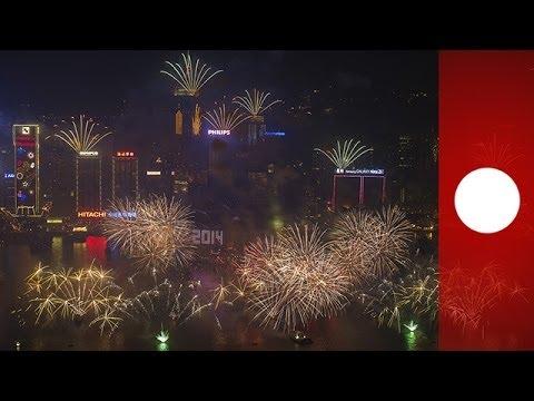 2014 : feux d'artifice sur l'opéra de Sydney et la Grande muraille de Chine