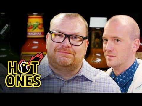 Superfan Brett Baker Grills Sean Evans Over Spicy Wings | Hot Ones