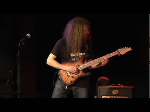 "Guthrie Govan (guitar), Bryan Beller (bass), and Marco Minnemann (drums), AKA The Aristocrats, perform Govan's song ""Erotic Cakes"" during a private concert for students at Musicians Institute, January 24. 2012. BONUS: The trio bursts into a spontaneous smartphone jam at 2:13."