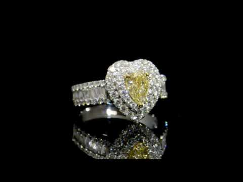 Lady's 18k White Gold Fancy Yellow Diamond Ring