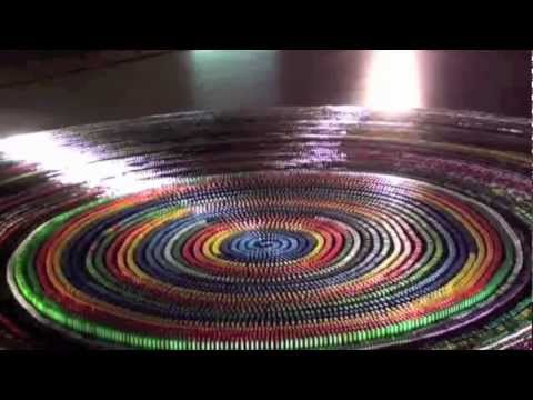 Spiral - http://www.sinnersdominoentertainment.com Here is the video including the complete spiral toppling from our event in January 2012. New Spiral World Record: 3...