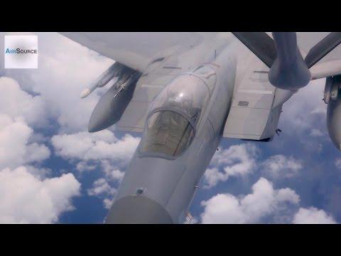 A KC-135 Stratotanker refuels F-15...