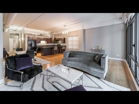 A 1-bedroom, 1 ½ bath Streeterville loft steps from the beach at Axis