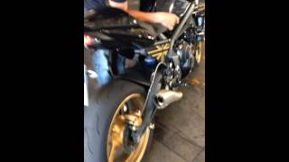 5. Triumph Street Triple R + HP Corse Hydroform 3 in 1 con @, no db
