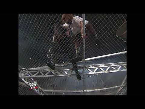 in nineteen ninety eight when the undertaker threw mankind off hеll in a cell, and plummeted sixteen feet through an announcer's table set to Africa by Toto