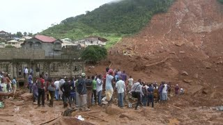 The Red Cross says more than 300 people were killed near the city of Freetown when a rain-soaked hillside collapsed early ...