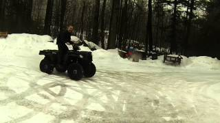 7. Sportsman 570 Donuts on icy driveway