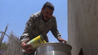 On a day off from the Raqa front line, Syrian fighter Iskandar was busy chopping up chicken and garlic cloves for a steaming pot of...
