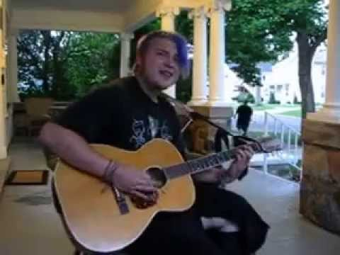 proudhon in manhattan - Dustin singing and playing his guitar for me on the front porch.