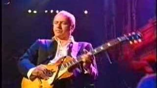 Mark Knopfler plays Local Hero Wild Theme, live at the Royal Albert Hall, London, Music for Montserrat concert, with his Gibson ...