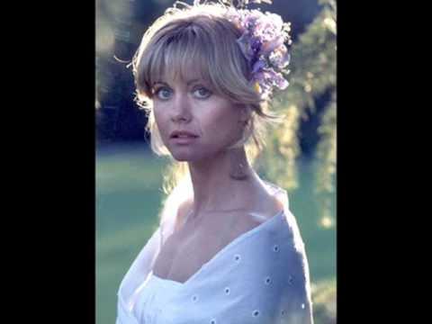 Tekst piosenki Olivia Newton John - Behind That Locked po polsku