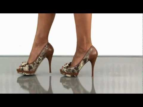 multiple heels and shoes - Visit: http://www.heels.com/womens-shoes/sanura-nat-multi-ll.html Feel like a temptress in these snake inspired pumps from Guess. Sanura has a natural snake ...